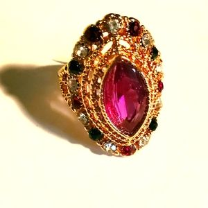 Gold style fashion ring with pink teardrop inset